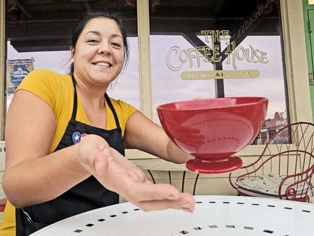 Coffee House owner Sylvia Hillo sits outside her shop in Newhall. Hillo, a culinary arts graduate, took over the coffee shop in August and has been running it with the help of friends and family.
