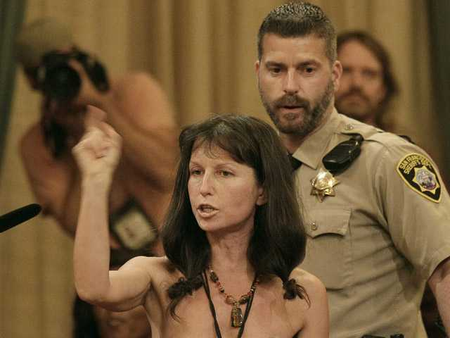 Protester Gypsy Taub speaks out against the Board of Supervisors decision to ban public nakedness while naked at City Hall in San Francisco on Tuesday.