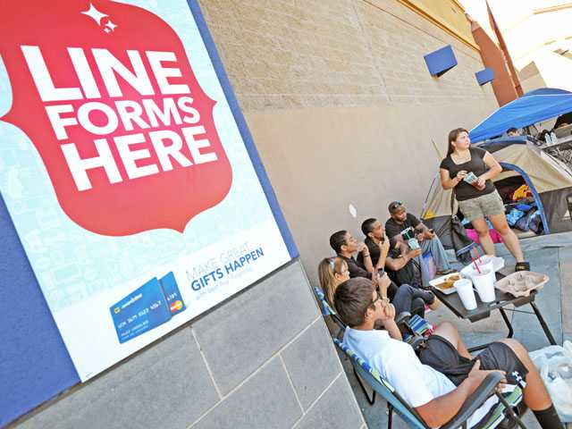 Jessica Valdez, right, is the first person in line for a Black Friday sale in Saugus. She is joined on Tuesday by, from left, her brother Benjamin and her mother Veronica Valdez, and friends Nick Shorts, Lyndan Coleman Jr. and Lyndan Coleman Sr. (Jonathan Pobre/The Signal)