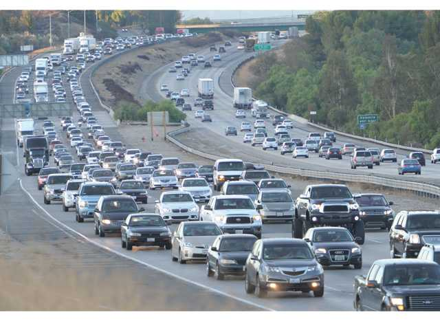 South bound holiday traffic, left, creeps along as the north bound moves steadily on the Interstate-5 as viewed from the Lyons Avenue overpass in Newhall  looking north on Wednesday evening.  (Dan Watson/The Signal)