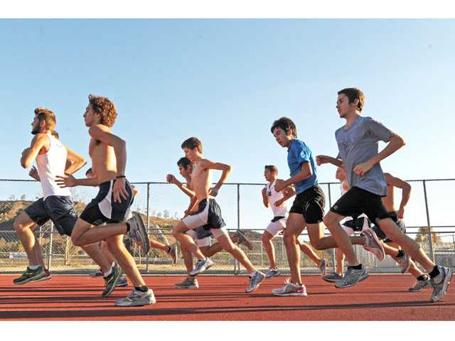 The Saugus High boys cross country team trains at Saugus High on Monday. The Centurions will compete Saturday in the CIF State Cross Country Championships.
