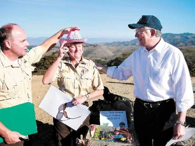 Bureau of Land Management Fort Ord Manager Eric Morgan, left, BLM ranger Tammy Jakl and Interior Secretary Ken Salazar look on Friday at Wildcat Ridge on Fort Ord. Salazar is to decide the fate of a California oyster farm.