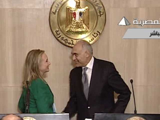 Image from Egyptian State Television, U.S. Secretary of State Hillary Rodham Clinton, left, and Egyptian Foreign Minister Mohammed Kamel Amr, right, shake hands after announcing a cease-fire between Israel and Hamas.