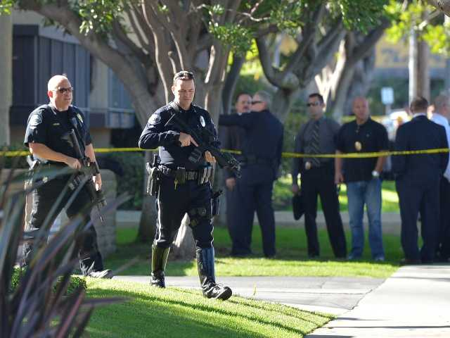 Torrance police and fire respond to a call at a double murder-suicide at the senior citizens' high-rise in Torrance Tuesday, Nov. 20.