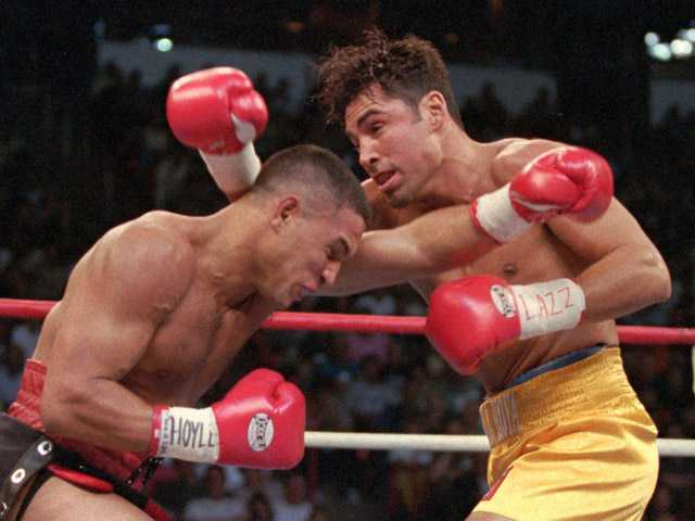 This Sept. 13, 1997, photo shows Hector Camacho, left, of Puerto Rico, and Oscar De La Hoya exchanging blows in  their WBC welterweight championship in Las Vegas.