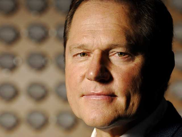Sports agent Scott Boras poses for a portrait in the lobby of the Boras Corporation headquarters in Newport Beach in this Sept. 5, 2008, photo.