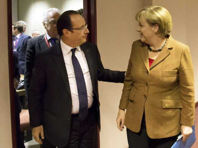 French President Francois Hollande, center, greets German Chancellor Angela Merkel.