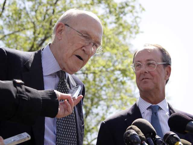 This April 14, 2011, photo shows Erskine Bowles, right, and Alan Simpson talking to reporters outside the White House in Washington after their meeting with President Barack Obama.