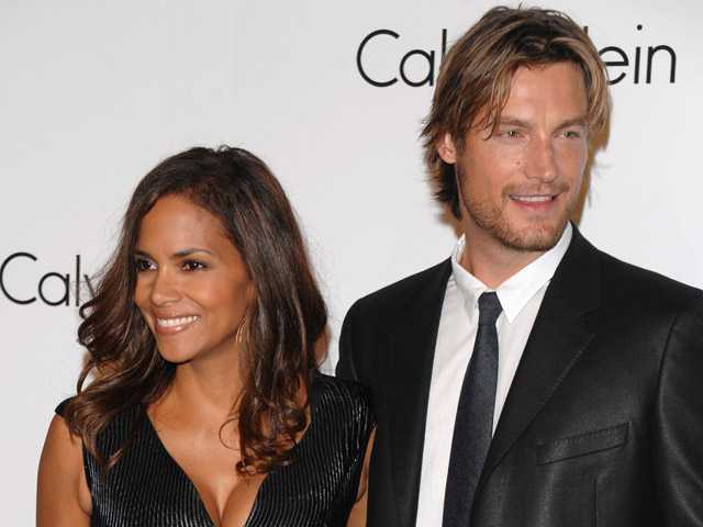 In this Sept. 7, 2008, photo, Model Gabriel Aubry and actress Halle Berry attends the Calvin Klein 40th anniversary party during Fashion Week in New York.
