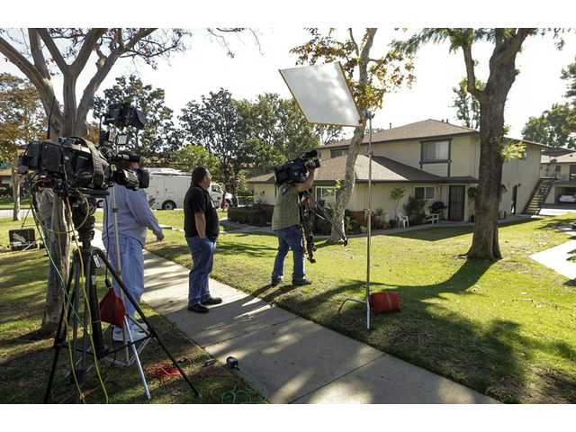 Media gather outside the home of Miguel Alejandro Santana Vidriales, one of four Southern California men accused of terrorist plotting.
