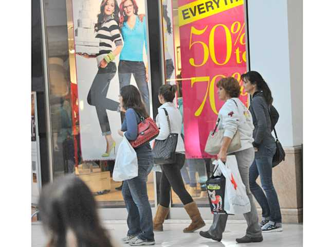 Shoppers hunt for bargains at the Westfield Valencia Town Center Mall on Black Friday morning.