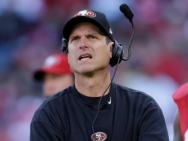 San Francisco 49ers head coach Jim Harbaugh walks on the sidelines during the third quarter of an NFL football game against the St. Louis Rams in San Francisco Nov. 11.