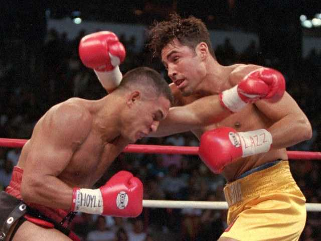 Hector Camacho, left, of Puerto Rico, and Oscar De La Hoya of Los Angeles exchanging blows in the first round of their WBC welterweight championship in Las Vegas Spet. 13, 1997.