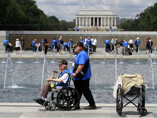 Retired Army Infantry Pfc. Marvin Kincaid, 85, of Thayer, Mo., left, at the the World War II Memorial in Washington as honor flight WWII veterans visited the site on the 68th anniversary of D-Day on June. 6.