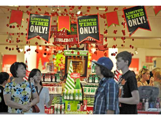 Shoppers walk past Bath & Body Works' holiday display at Westfield Valencia Town Center on Friday.