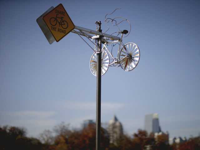 "Alex Rodriguez' public art project titled ""Whirling Wheels,"" is seen against the midtown skyline along the Atlanta BeltLine in Atlanta, on Nov. 20."