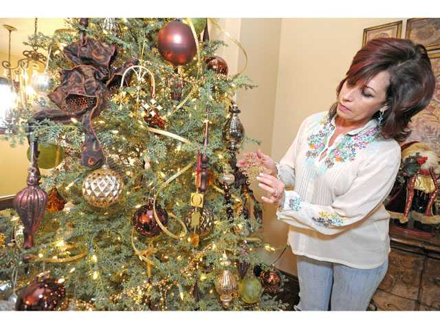 Paula Nichols with a decorated tree in her Westridge home.