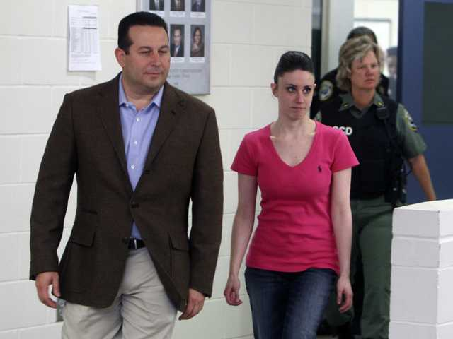 Casey Anthony, front right, walks out of the Orange County Jail during her release in Orlando, Fla., after being acquitted of murder in the death of her daughter Caylee.