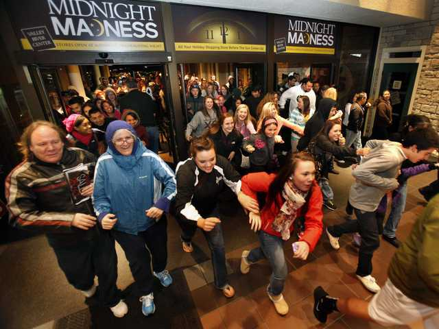 Black Friday shoppers pour into the Valley River Center mall for the Midnight Madness sale, in Eugene, Ore., on Nov. 23.
