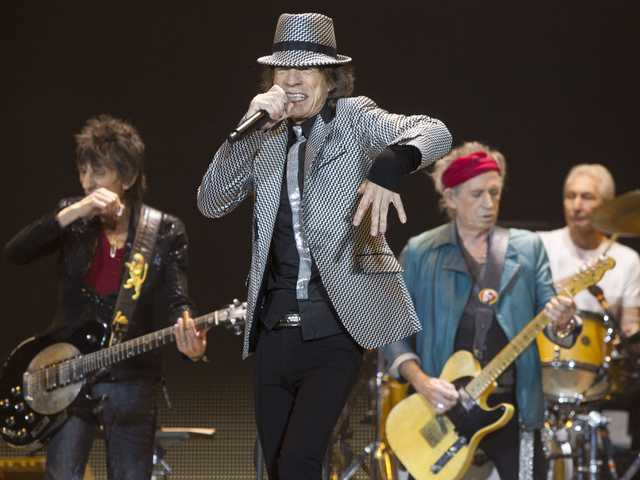 Mick Jagger, center, Keith Richards, Ronnie Wood, left, and Charlie Watts, right, of The Rolling Stones perform at the O2 arena in east London, on Sunday.