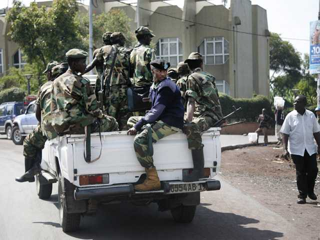 M23 rebels patrol around Congo's Central Bank in Goma, eastern Congo.