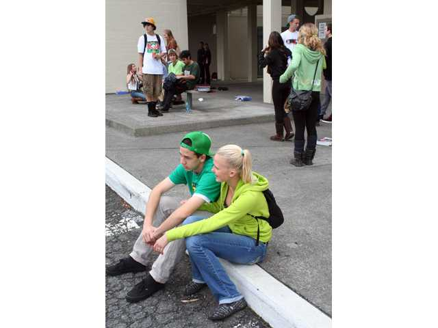 Arcata High School students wear green colored clothing in tribute to fellow student Gregory Kulijan Monday.