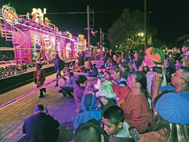 Hundreds watch as the Holiday Toy Express pulls into the Jan Heidt Metrolink station in Newhall on Saturday.