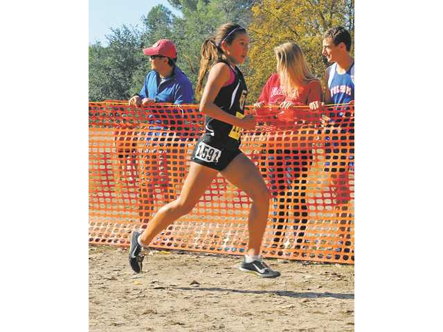 Golden Valley freshman Bianca Tinoco competes in the girls Division II race on Saturday at the CIF State Cross Country Championships at Woodward Park in Fresno.