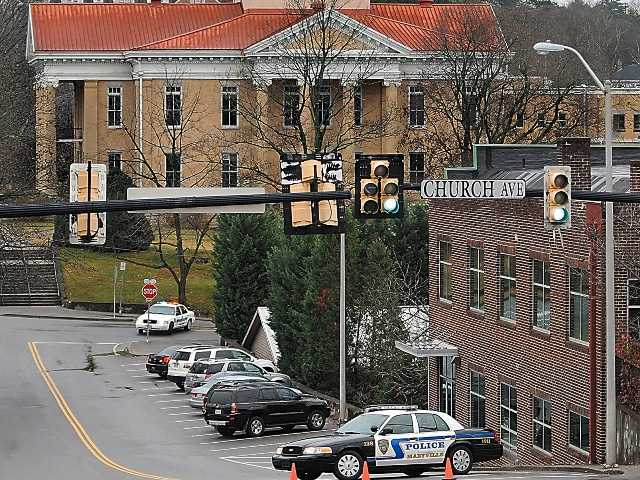 Police close roads surrounding the Blount County Courthouse Tuesday afternoon Nov. 27, 2012 after a bomb threat.  Bomb threats forced the evacuation of 24 courthouses across Tennessee Tuesday morning.