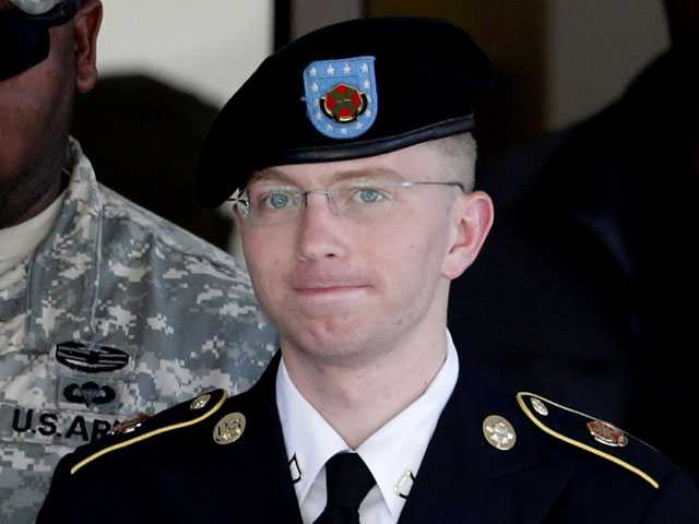 Army Pfc. Bradley Manning, right, is escorted out of a courthouse in Fort Meade, Md.
