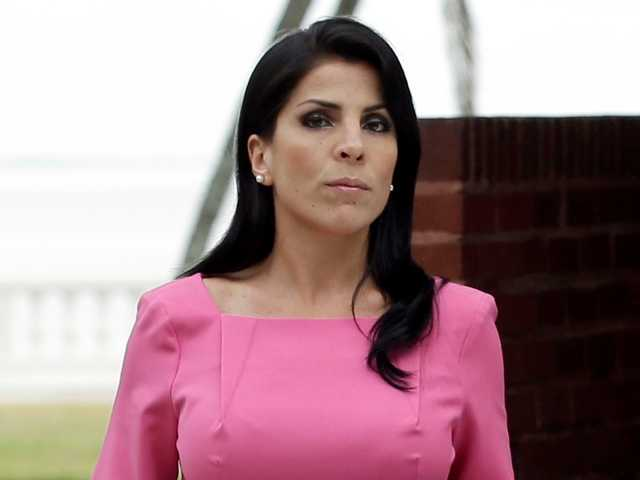 Jill Kelley leaves  her home Tuesday, Nov 13, 2012 in Tampa, Fla. South Korea will revoke an honorary title given to the American socialite tied to the scandal involving former CIA director David Petraeus.