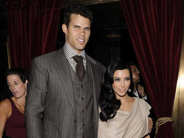 This Aug. 31, 2011, photo shows Kim Kardashian and Kris Humphries attending a party thrown in their honor at Capitale in New York.