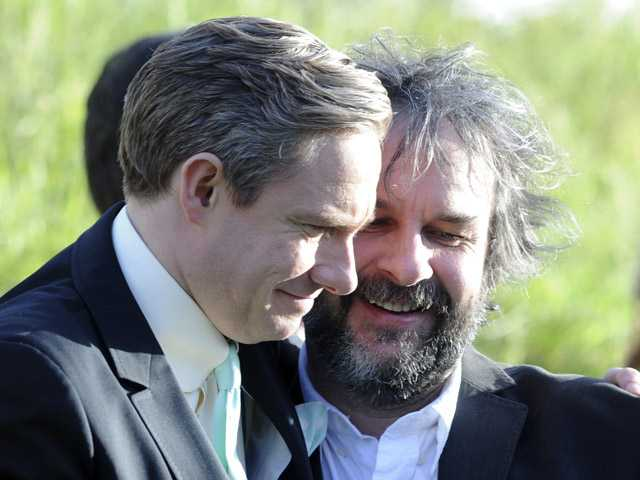 "Cast member Martin Freeman, left, embraces director Peter Jackson at the premiere of ""The Hobbit: An Unexpected Journey,"" at the Embassy Theatre, in Wellington, New Zealand, on Wednesday."