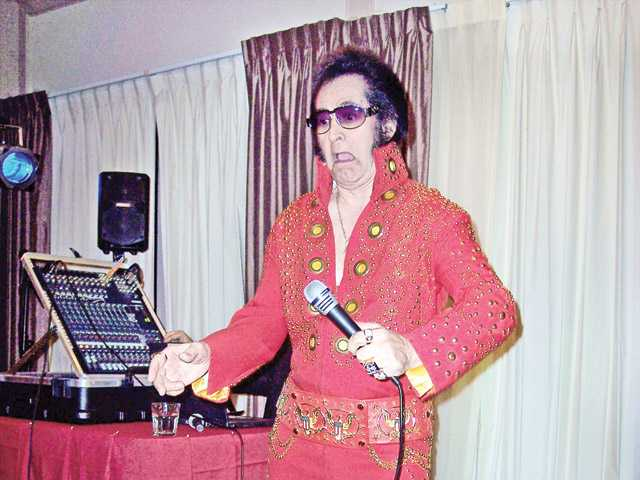 Armand Kay, as Elvis, entertains the crowd at the Zonta Tribute Dinner for Shelley Hann.