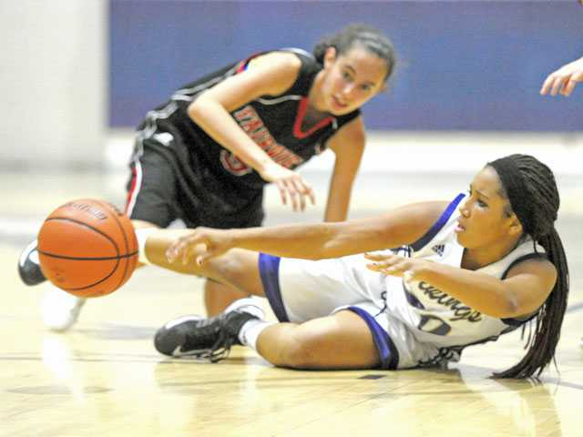 Valencia's Talia Roth (20) passes ahead of Fairview's Annika Lai on Wednesday at Valencia High.