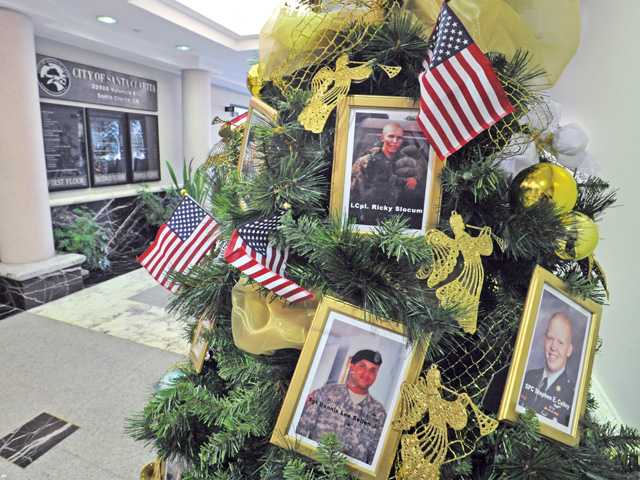 Visitors to Santa Clarita City Hall walk past the Gold Star holiday tree, at City Hall on Wednesday. City officials invite the public to attend a reception honoring the Santa Clarita Valley's Gold Star Families — those who have lost a loved one in defense of the nation — on Dec. 12, from 6-8 p.m. For more information, contact Corrina Knudson at 661-255-4939.