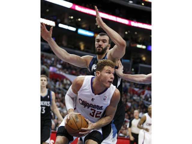 Los Angeles Clippers' Blake Griffin is pressured by Minnesota Timberwolves' Nikola Pekovic during the first half  in Los Angeles, Wednesday.