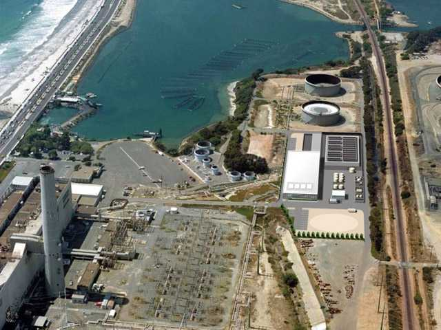 This image provided by the San Diego County Water Authority shows an artist rendering of a proposed desalination plant, center right, superimposed over an aerial photograph, in Carlsbad.