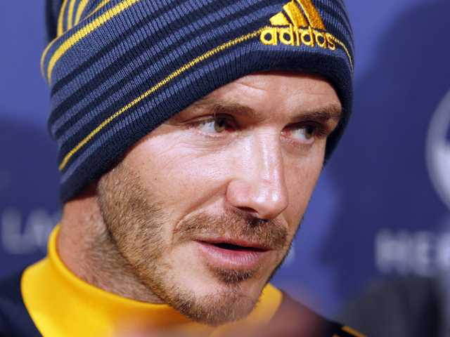 Los Angeles Galaxy's David Beckham, of England, talks with reporters during a news conference in Carson, on Nov. 20, 2012. Beckham will play his final soccer game for the Galaxy in the MLS Cup next month.