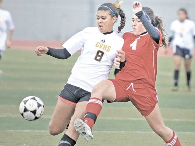 Golden Valley's Courtney Ravenell (8) advances the ball as Lancaster's Natalie Mitchell defends on Thursday at Golden Valley High.