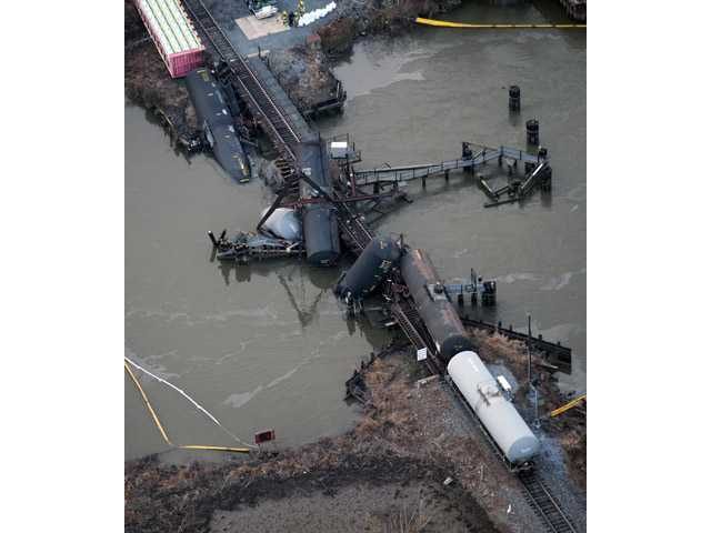 Several cars lay in the water after a freight train derailed in Paulsboro, N.J., Friday.