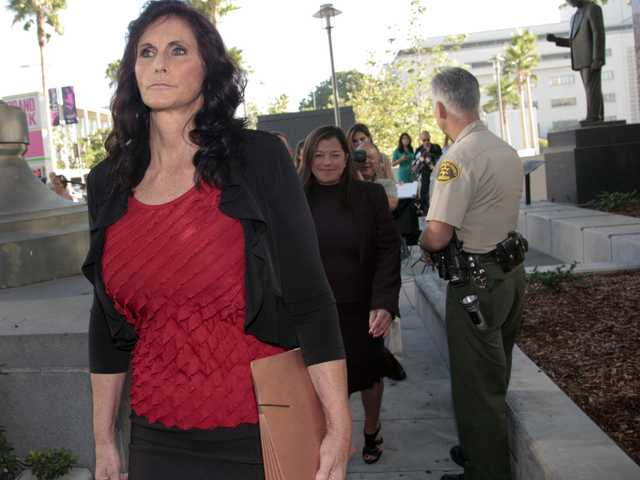 "In this Sept. 20 file photo, Cindy Lee Garcia, one of the actresses in ""Innocence of Muslims,"" left, arrives for a hearing at Los Angeles Superior Court in Los Angeles."