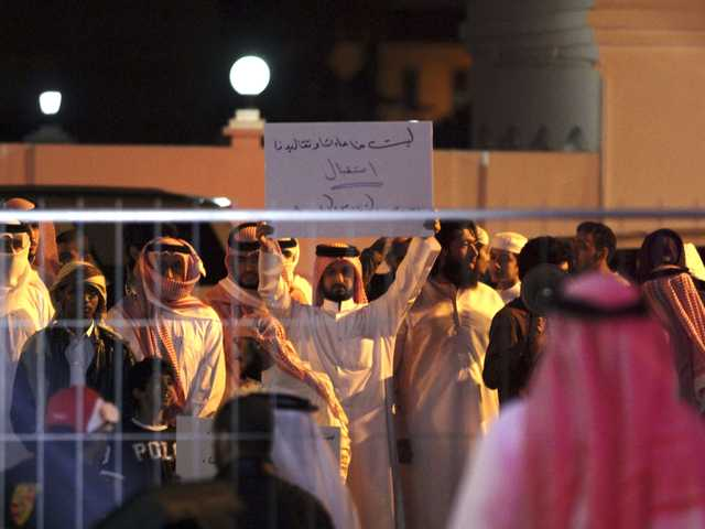 "Bahraini protesters chant slogans and one holds a banner that reads, ""none of our customs and traditions allow us to receive stars of porn movies,"" referring to TV star Kim Kardashian, in Riffa, Bahrain, on Saturday."