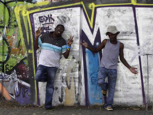 Tshepo Hoato, left, and colleague, Mongezi Sosibo, pose for a photo in Johannesburg on Thursday. The two help run a support group for teens at the Themba Lethu, HIV/AIDS Clinic, in Johannesburg.