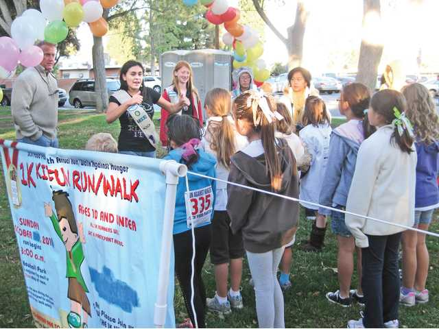 Children line up for the 1K Kiddie Run organized by Girls Scout Troop 7392 at the annual Run for Hunger.