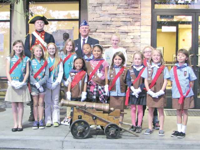 "Girl Scout Troop 5282 gathers in front of the Valencia Chick-Fil-A to honor veterans during a recent ""Thank a Veteran"" event and fundraiser. A volunteer is dressed as a 1776 soldier."
