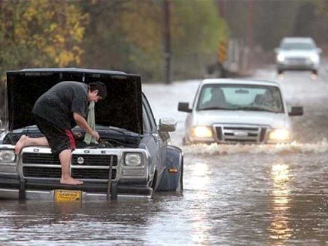 Milton Lopez of Windsor, Calif., attempted to drive through flood waters on Mark West Station Road at Starr Road, Friday, Nov. 30, 2012 in Windsor. The second in a series of storms slammed Northern California on Friday as heavy rain and strong winds knocked out power, tied up traffic and caused flooding along some stretches.