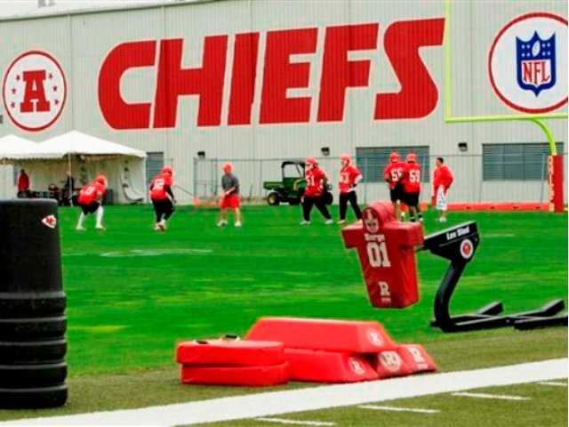 Kansas City Chiefs football players work out during an NFL football mini camp at the team's practice facility in Kansas City, Mo. Police say a 25-year-old Kansas City Chiefs player was involved in two shootings Saturday, Dec. 1, 2012, one of which occurred in the parking lot near Arrowhead Stadium.