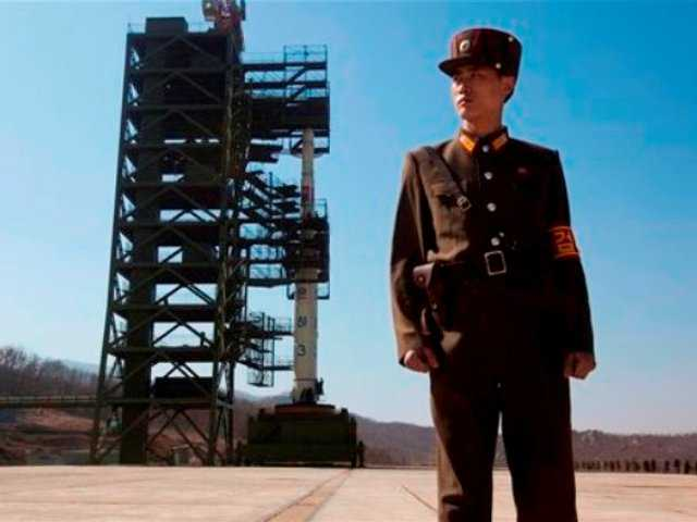 A North Korean soldier stands in front of the country's Unha-3 rocket at Sohae Satellite Station in Tongchang-ri, North Korea. North Korea has announced it will launch a long-rage rocket sometime in mid-December.