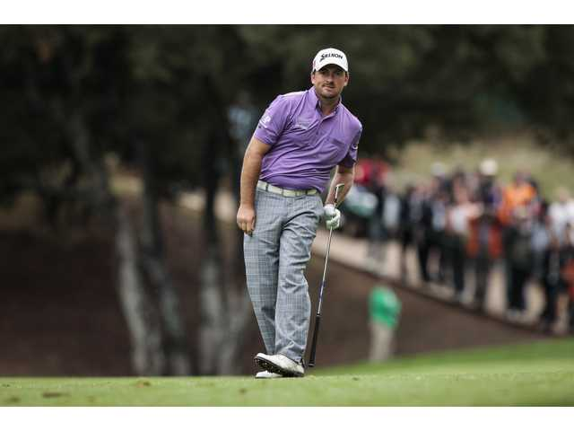 Graeme McDowell watches his second shot on the 18th hole during the third round of the World Challenge golf tournament at Sherwood Country Club in Thousand Oaks on Saturday.